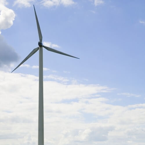 Wind turbine by dirt road