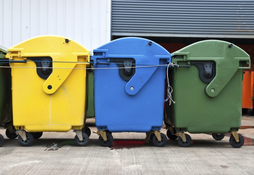 Three Large Bins In Green, Blue And Yellow