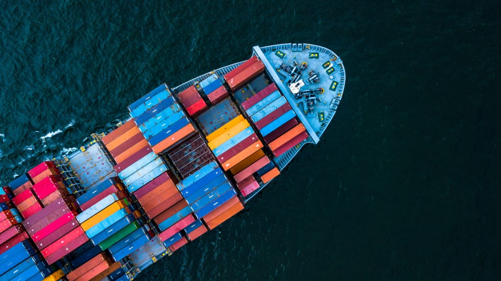 A Large Boat Carrying Shipping Containers