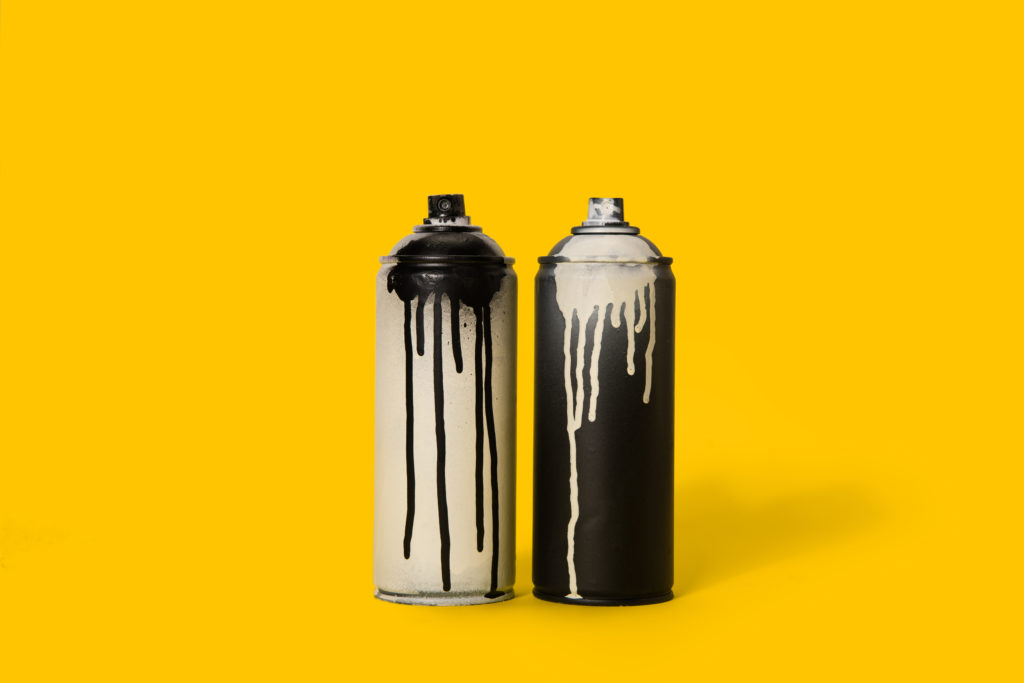 Two Paint Spray Cans One Black With White Paint & One White Can With Black Paint
