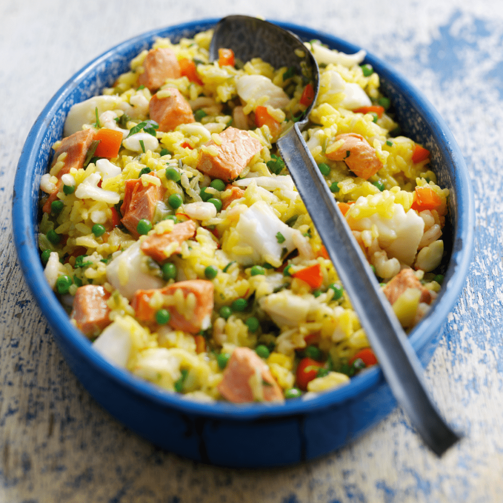 A Bowl Of Paella With A Spoon