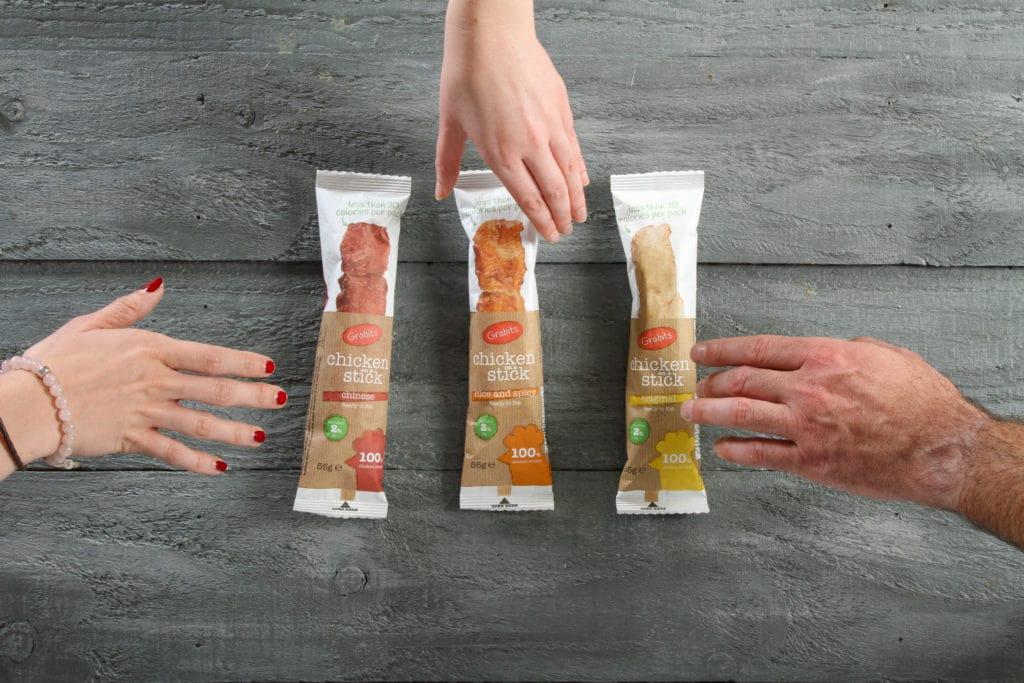 Three Hands Grabbing Grabits Chicken Sticks