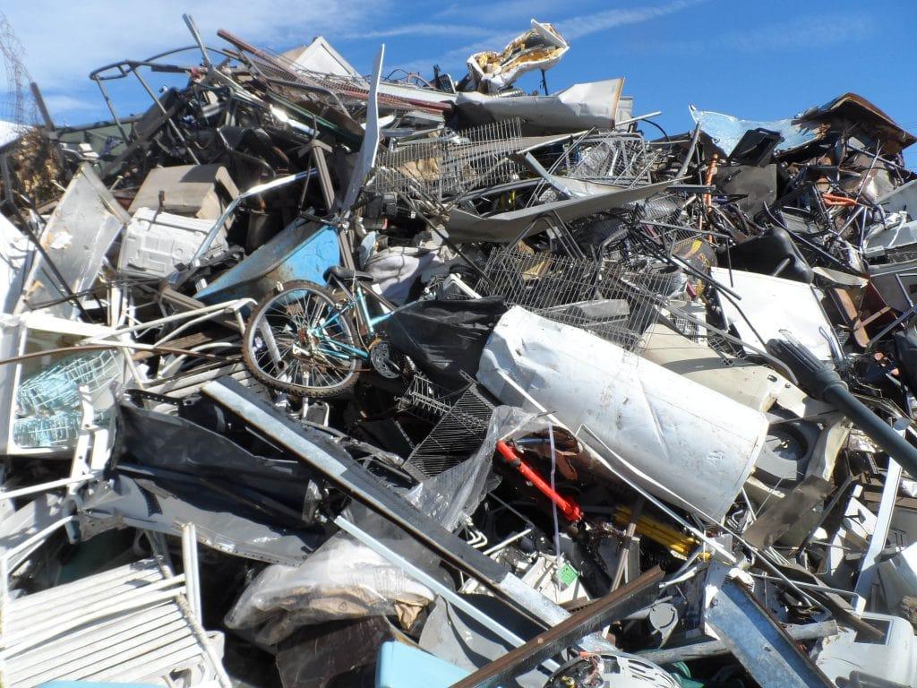 A Pile Of Scrap Metal Or Waste Metal