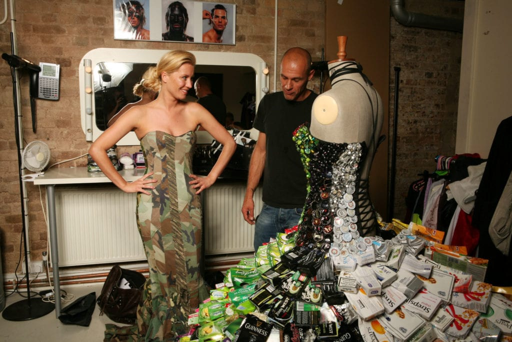 Two People Admiring A Dress Made Of Recycled Materials