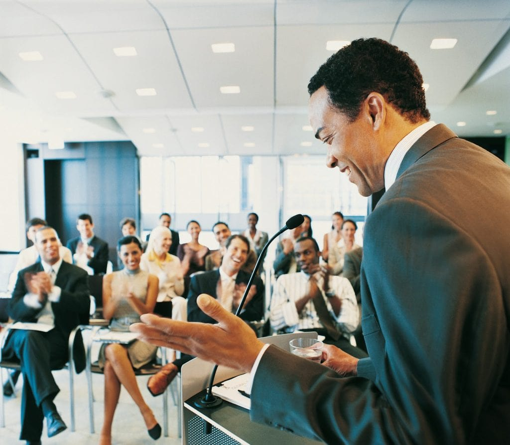 A Male Speaker Talking At A Conference