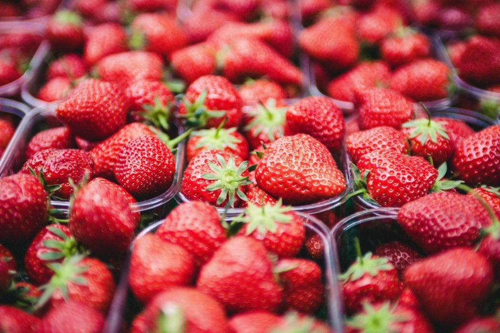 A Close Up Of Boxes Of Strawberries