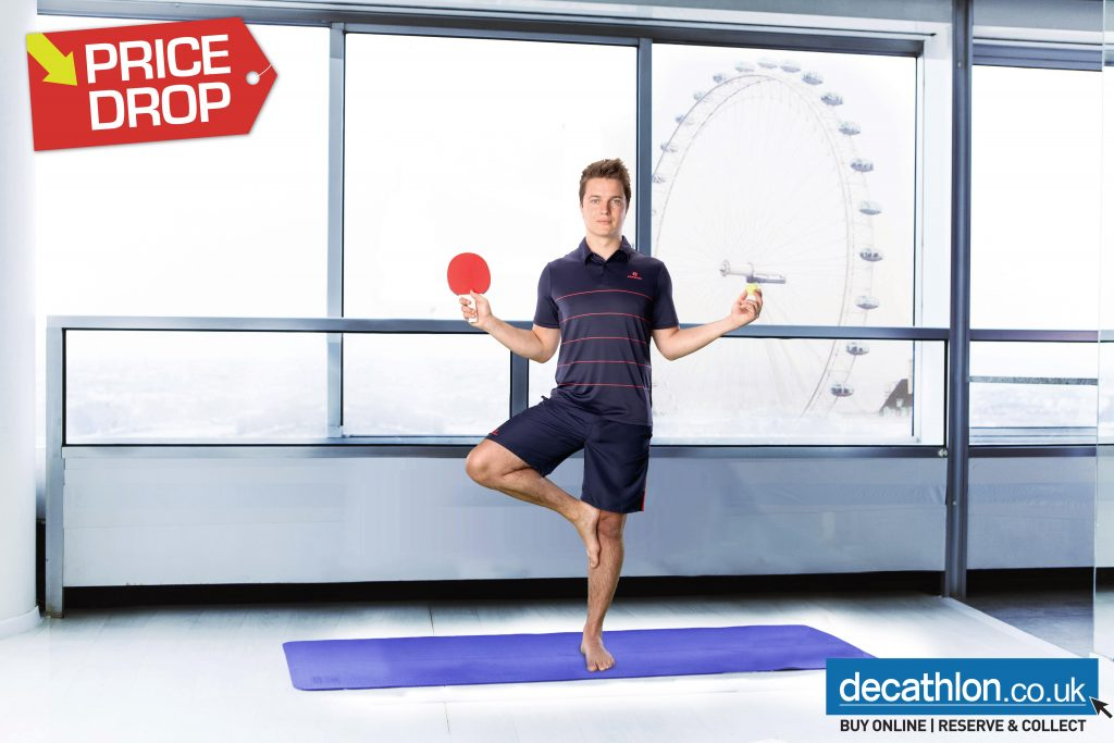 A Man Doing Yoga With A Table Tennis Paddle