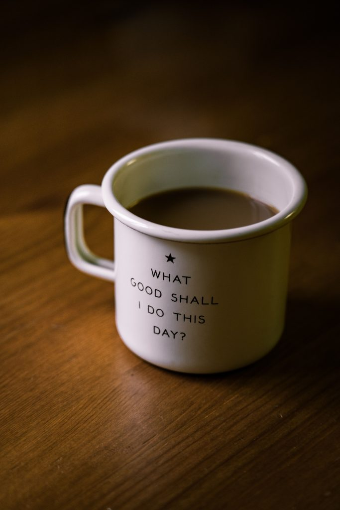 """A Coffee Mug With """"What Good Shall I Do This Day?"""" Written On It"""