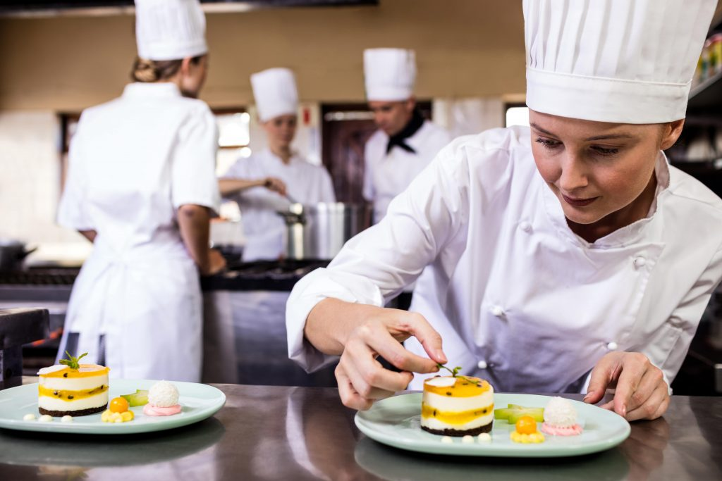 A Chef Adding Finishing Touches To A Dessert