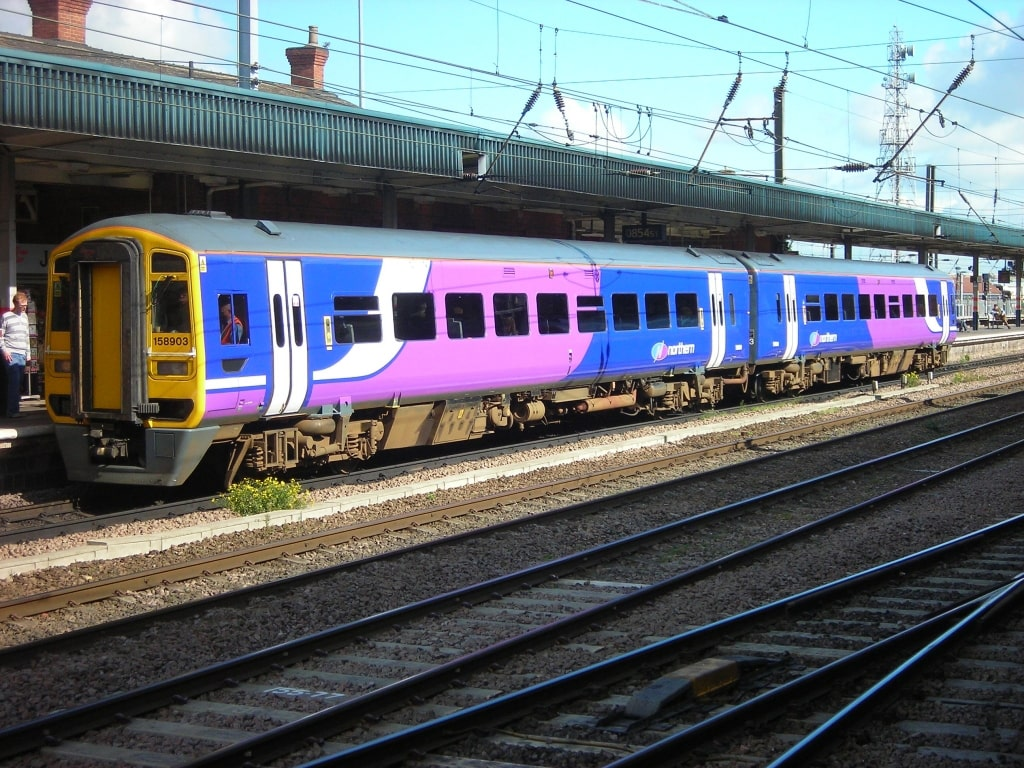 A Northern Rail Branded Train At A Station